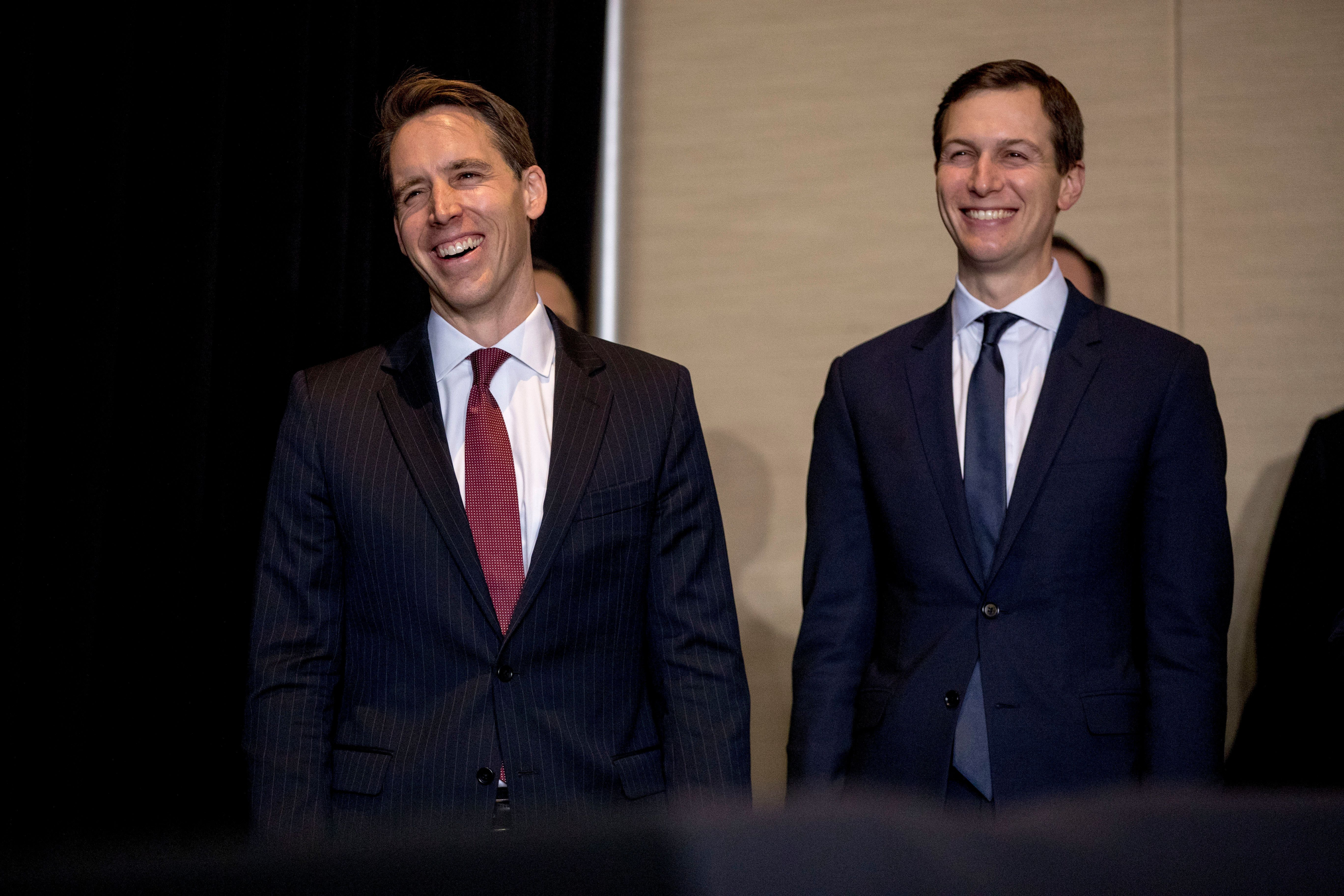 Sen.-elect Josh Hawley, R-Mo., left, accompanied by President Donald Trump's White House Senior Adviser Jared Kushner, right, smiles as he is recognized by President Donald Trump as he speaks the 2018 Project Safe Neighborhoods National Conference at the Westin Kansas City at Crown Center in Kansas City, Mo., Friday, Dec. 7, 2018. (AP Photo/Andrew Harnik)