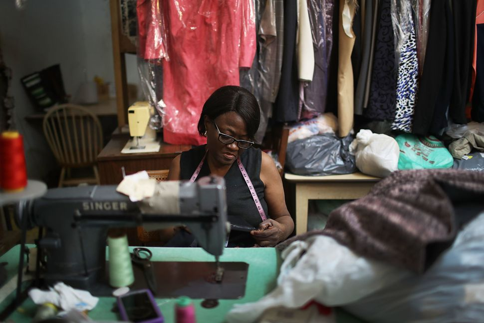 Juliette Virgile works in the tuxedo store in the Little Haiti neighborhood, Miami, which has been in her family for 32 years
