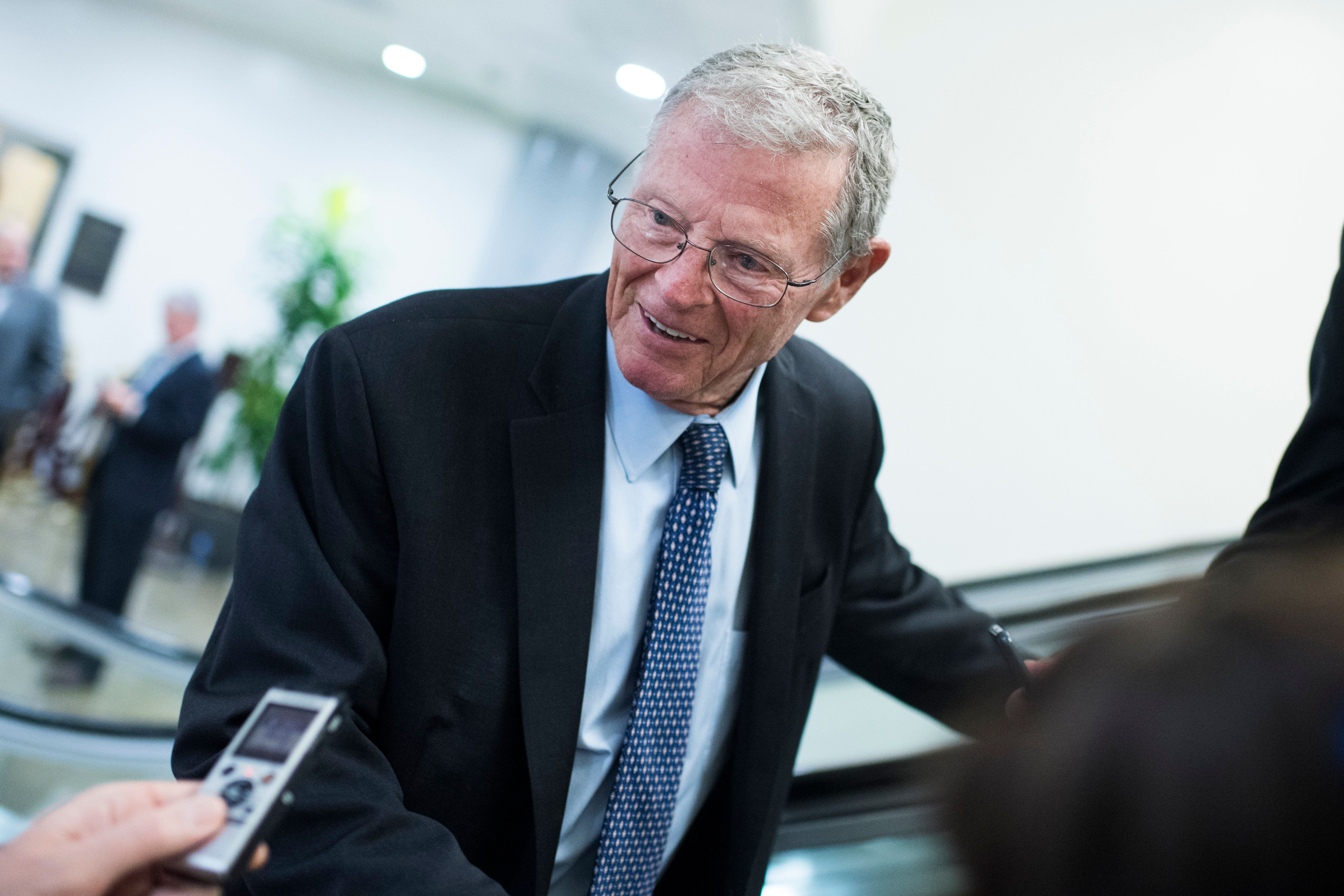 UNITED STATES - SEPTEMBER 25: Sen. James Inhofe, R-Okla., talks with reporters in the basement of the Capitol before the Senate policy luncheons on September 25, 2018. (Photo By Tom Williams/CQ Roll Call)