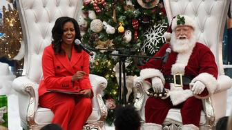 AURORA, CO - DECEMBER 13: Former First Lady of the United States, Michelle Obama, left, and Santa Claus talk patients at Children's Hospital Colorado ahead of her book signing event later in the day at the Tattered Cover and tour event later in the evening at the Pepsi Center December 13, 2018. (Photo by Andy Cross/The Denver Post via Getty Images)
