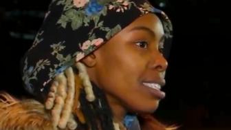 In this image made from video provided by WABC-TV/ABC7, Jazmine Headley speaks to the media after she was released from the Rikers Island jail facility in New York on Tuesday, Dec. 11, 2018. Headley, who was being held on a warrant in an unrelated credit card fraud case in New Jersey, is due to appear in court Wednesday in that matter. (WABC-TV/ABC7 via AP)