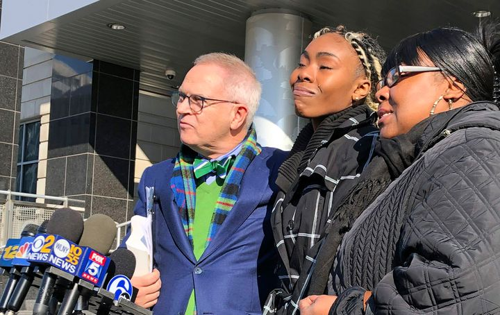 Jazmine Headley, center, was reunited with her 1-year-old son after he was forcibly taken from her arms while waiting at a so