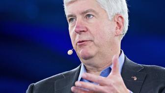 Rick Snyder, governor of Michigan, speaks during a panel discussion at the Goldman Sachs 10,000 Small Businesses Summit in Washington, D.C., U.S., on Tuesday, Feb. 13, 2018. Goldman's 10,000 Small Businesses is an investment that brings economic opportunity and assists entrepreneurs to create jobs by providing better access to education, capital and business support services. Photographer: Andrew Harrer/Bloomberg via Getty Images