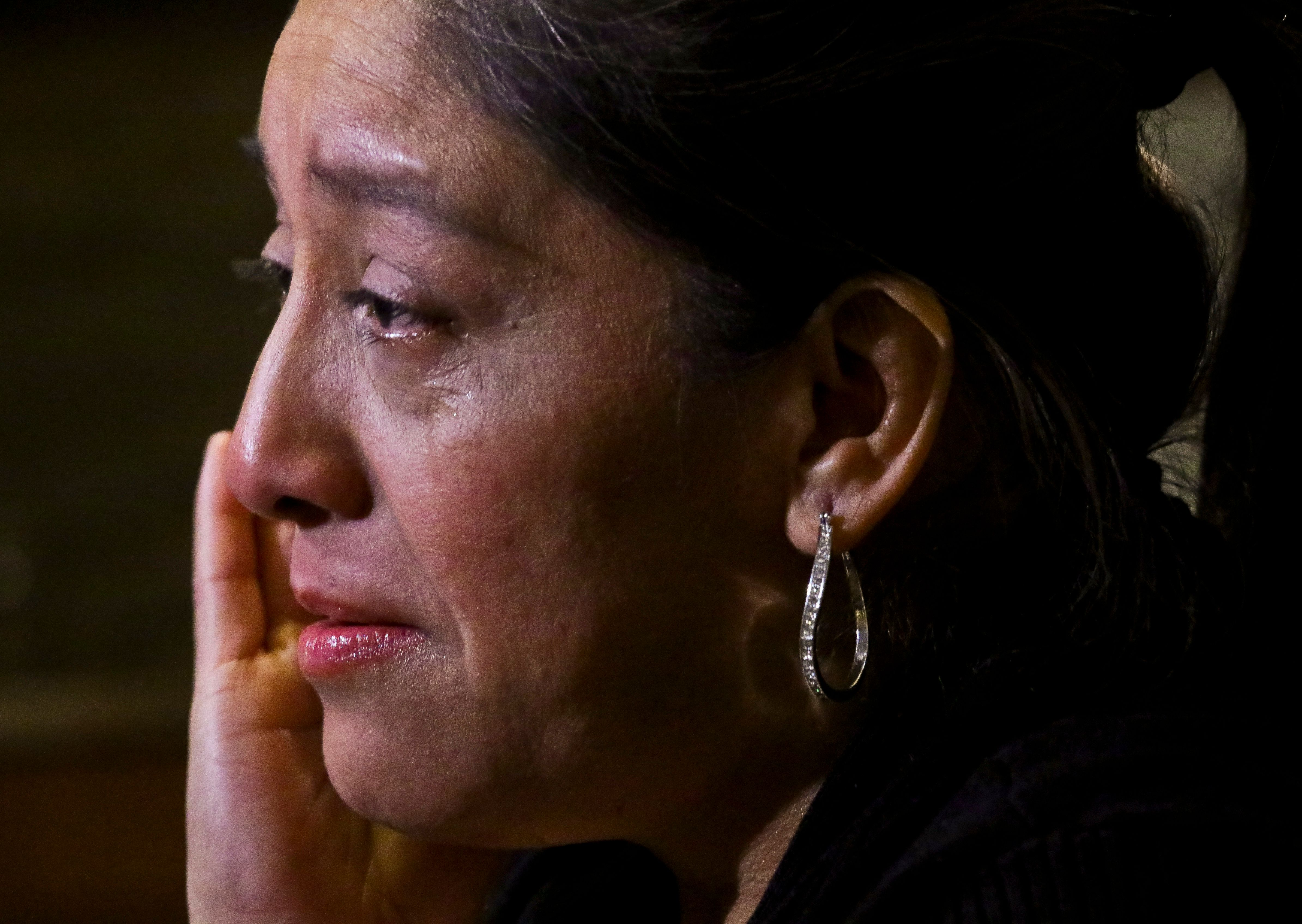 "Victorina Morales becomes tearful during an interview, as she recalls ""humiliating"" treatment at the hands of a supervisor while working at President Donald Trump's golf resort in Bedminster, N.J., Friday Dec. 7, 2018, in New York. Morales say she used false legal documents to get hired and supervisors knew it. (AP Photo/Bebeto Matthews)"