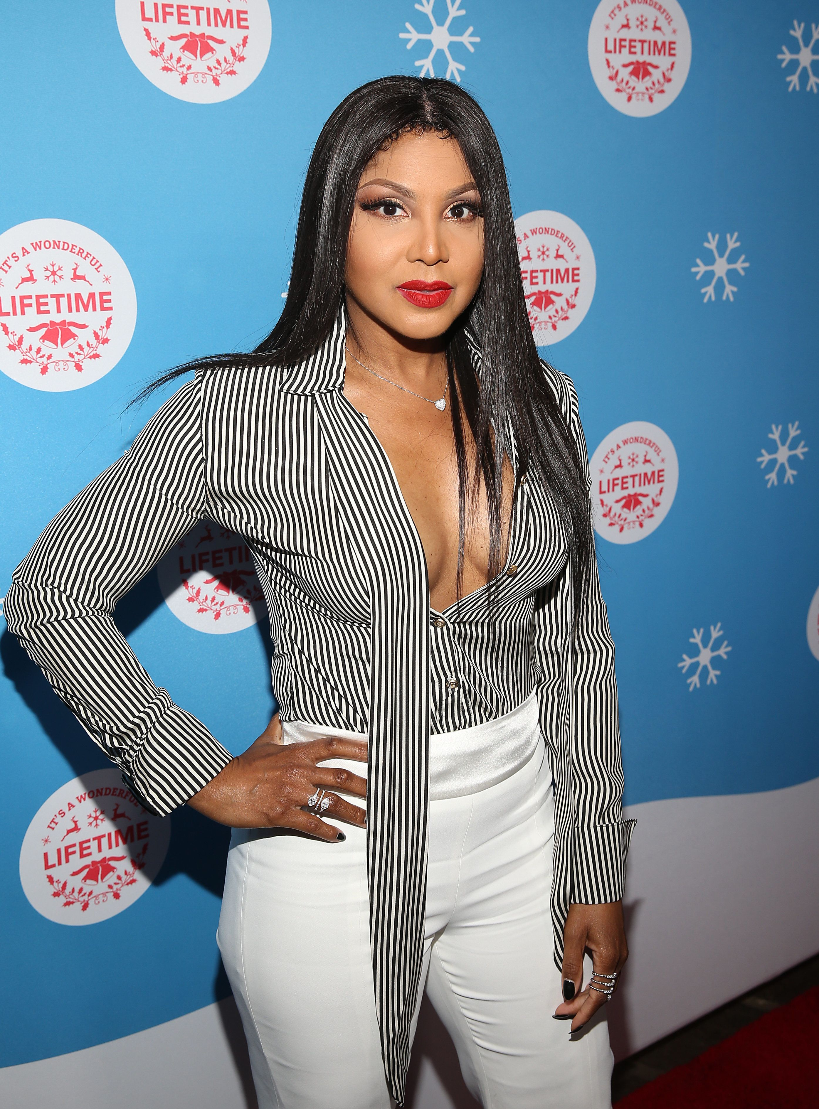 """LOS ANGELES, CALIFORNIA - NOVEMBER 14: Toni Braxton attends the VIP opening night of the life-sized gingerbread house in celebration of """"It's A Wonderful Lifetime' at The Grove on November 14, 2018 in Los Angeles, California. (Photo by Jesse Grant/Getty Images for Lifetime )"""