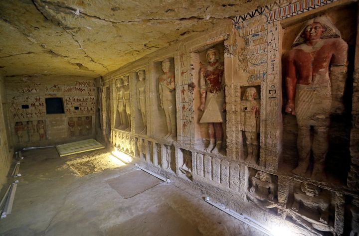 The walls are decorated with hieroglyphs and statues of pharaohs.