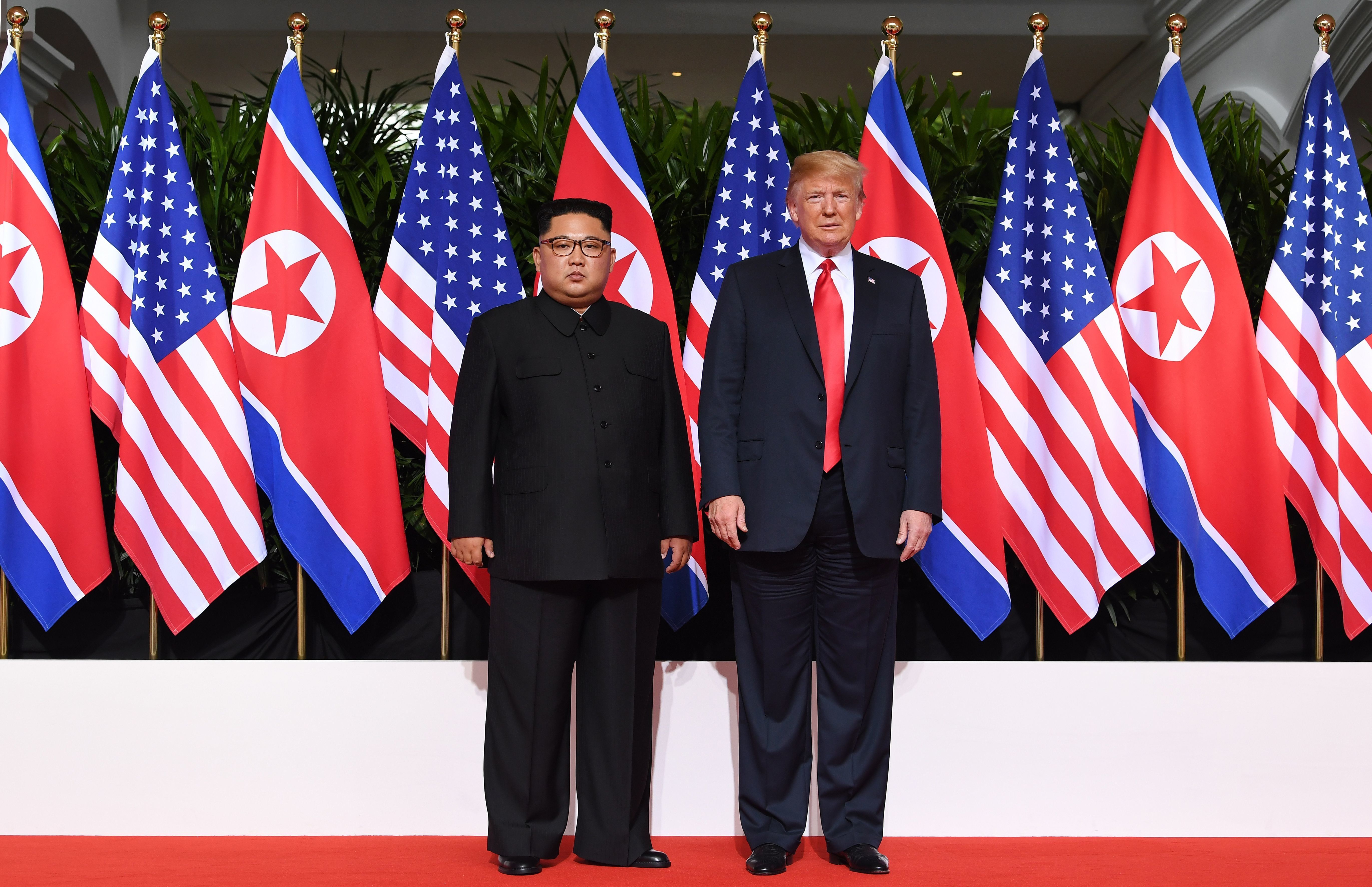 US President Donald Trump (R) poses with North Korea's leader Kim Jong Un (L) at the start of their historic US-North Korea summit, at the Capella Hotel on Sentosa island in Singapore on June 12, 2018. - Donald Trump and Kim Jong Un have become on June 12 the first sitting US and North Korean leaders to meet, shake hands and negotiate to end a decades-old nuclear stand-off. (Photo by SAUL LOEB / AFP)        (Photo credit should read SAUL LOEB/AFP/Getty Images)