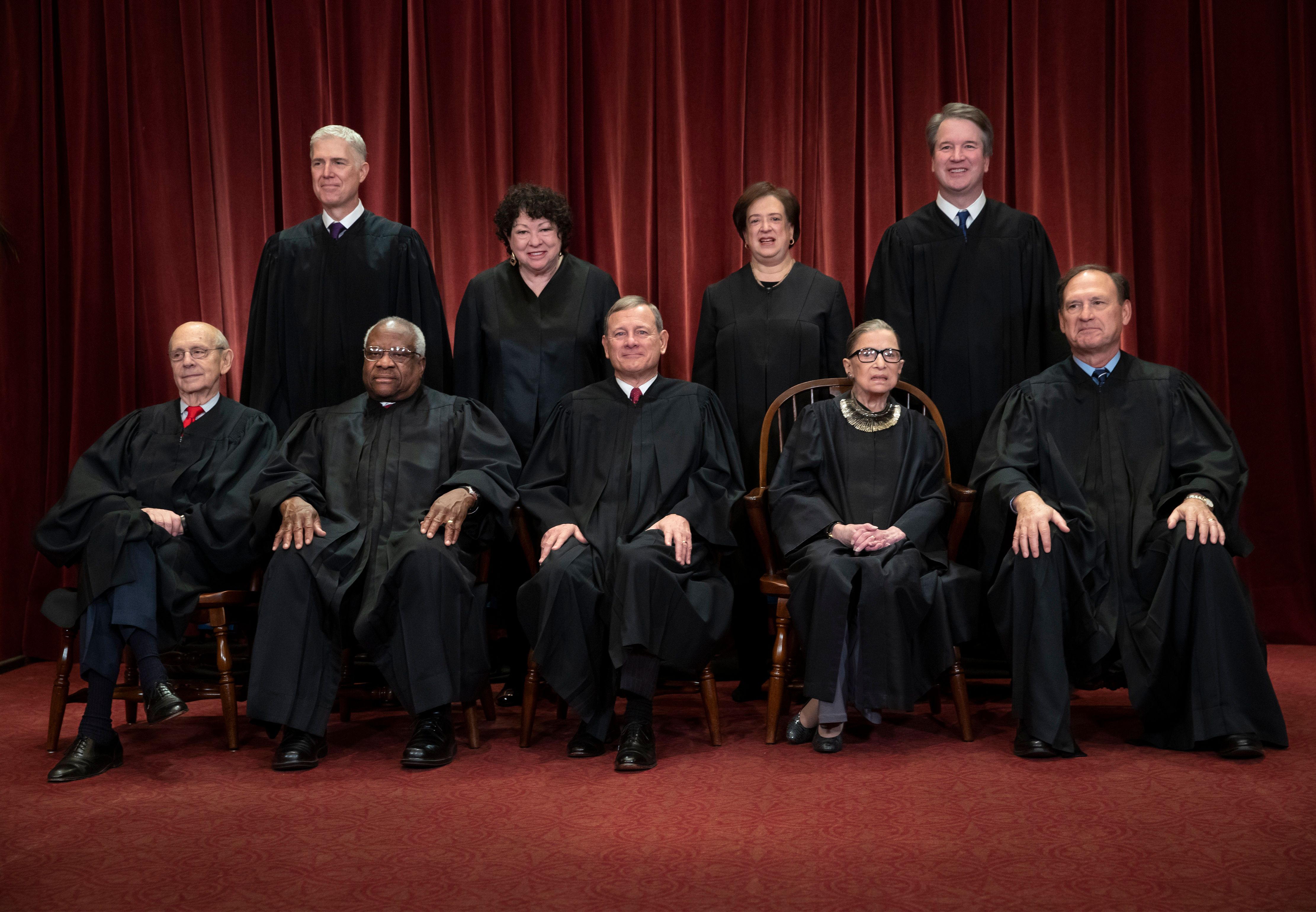 The justices of the U.S. Supreme Court gather for a formal group portrait on Nov. 30. Seated from left: Stephen Breyer, Clarence Thomas, John Roberts, Ruth Bader Ginsburg and Samuel Alito Jr.