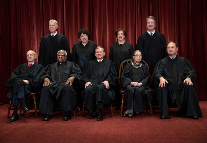 The justices of the U.S. Supreme Court gather for a formal group portrait on Nov. 30. Seated from left: Stephen Breyer, Clare