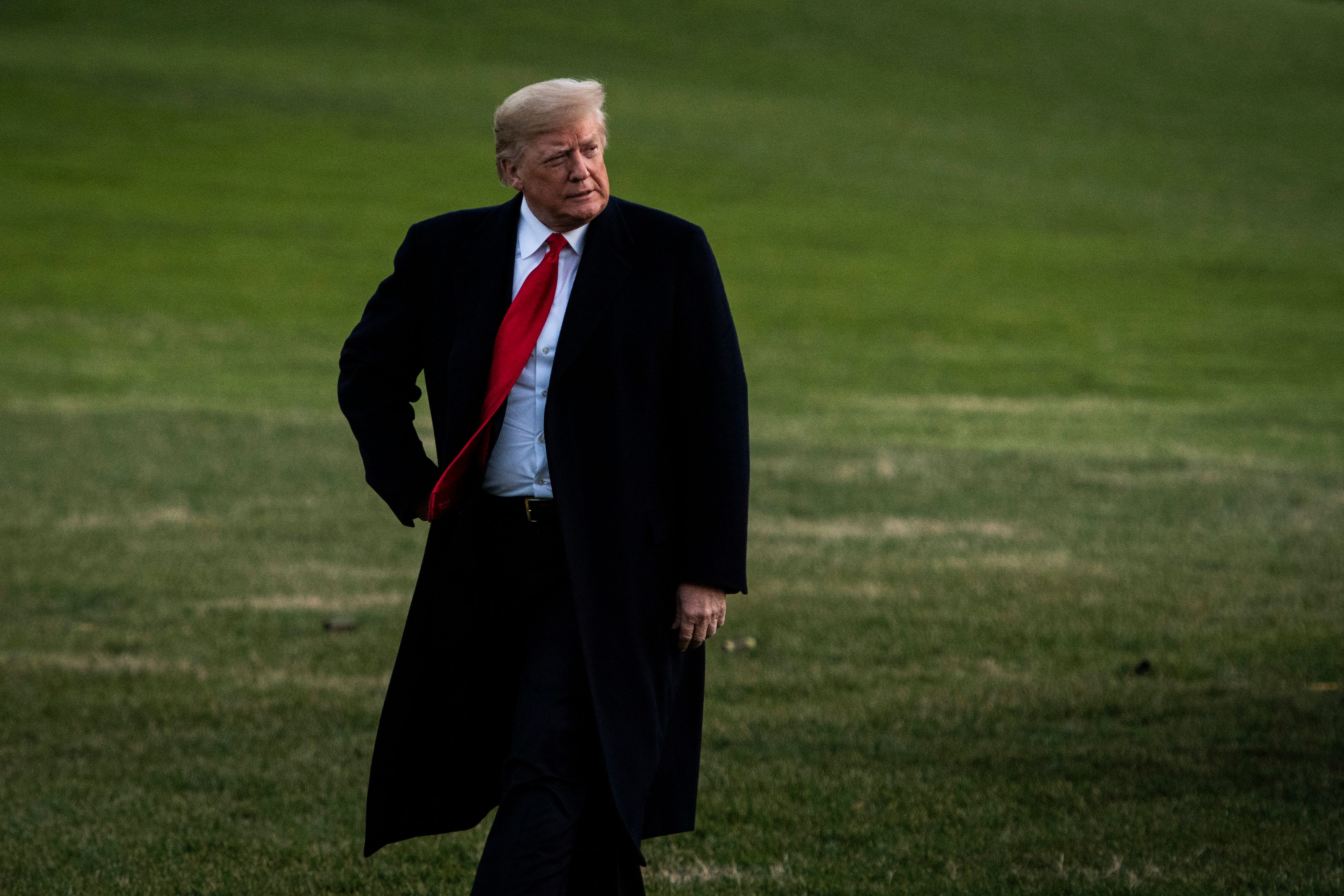 WASHINGTON, DC - DECEMBER 7 : President Donald J. Trump disembarks Marine One and walks back across the South Lawn of the White House on Friday, Dec. 07, 2018 in Washington, DC. (Photo by Jabin Botsford/The Washington Post via Getty Images)