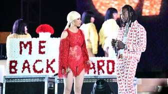 LOS ANGELES, CALIFORNIA - DECEMBER 15: Singer Cardi B (L) is presented a 'Take Me Back' card onstage by her husband Offset (R) during day 2 of the Rolling Loud Festival at Banc of California Stadium on December 15, 2018 in Los Angeles, California. (Photo by Scott Dudelson/Getty Images)
