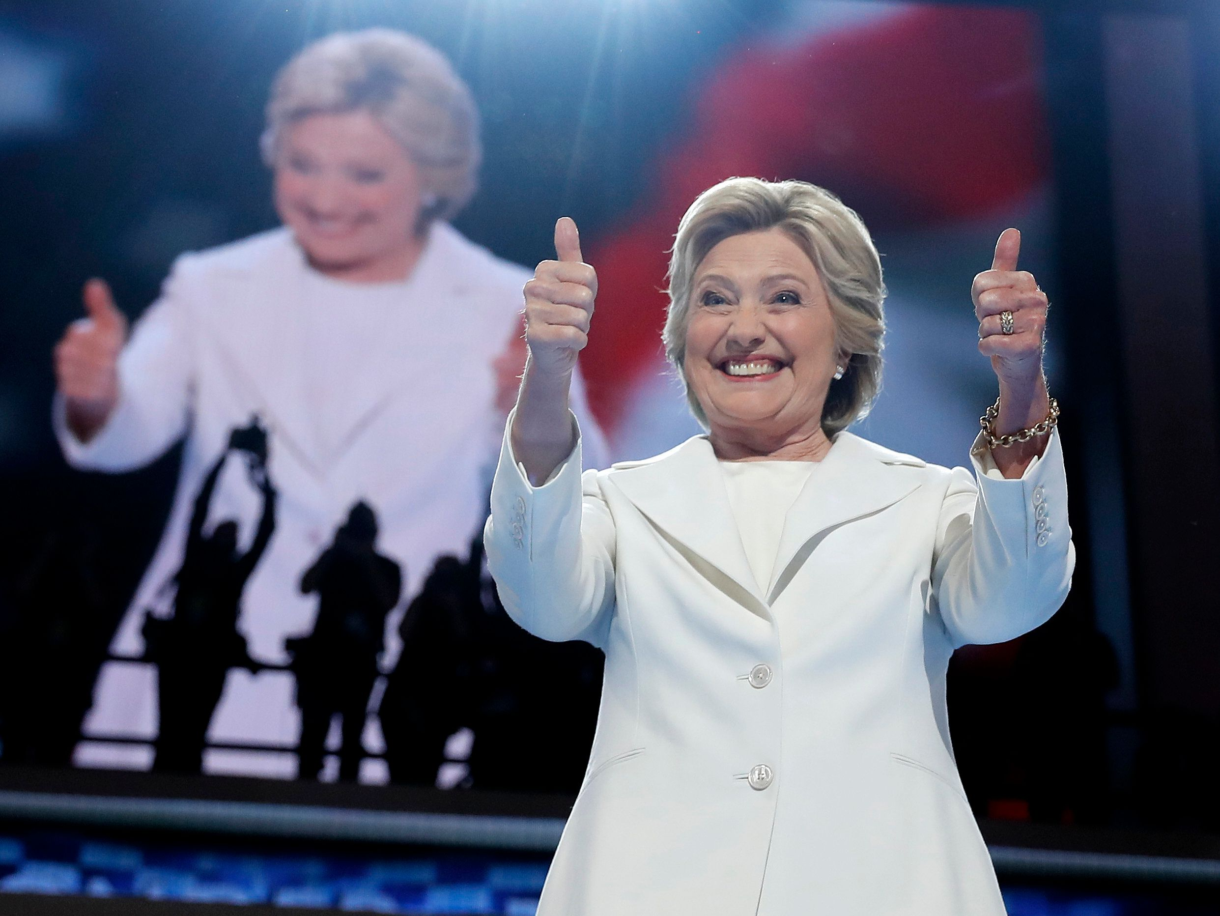 Democratic presidential nominee Hillary Clinton gives her thumbs up as she appears on stage during the final day of the Democratic National Convention in Philadelphia, Thursday, July 28, 2016. (AP Photo/Carolyn Kaster)