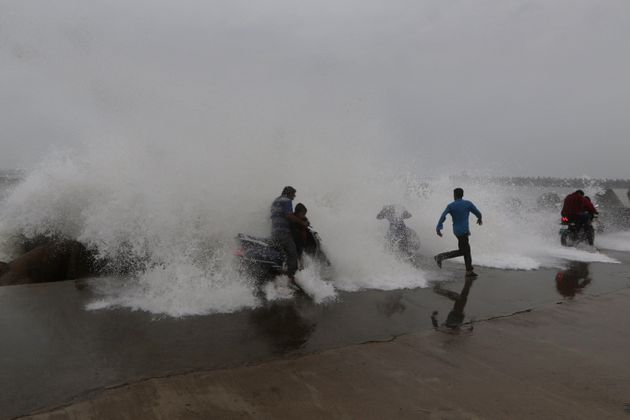High waves hit the Kasimedu harbor on the Bay of Bengal coast in Chennai, India, Sunday, Dec. 16,
