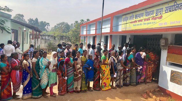Voters line up to vote at a polling station in Sukma in Chhattisgarh state on 12