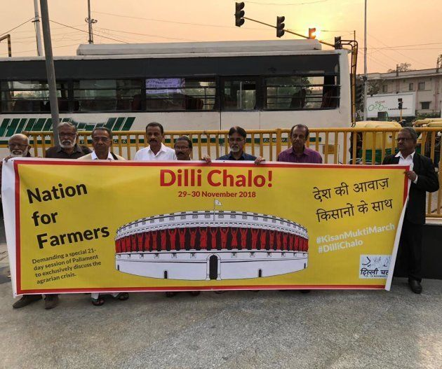 Artistes with banners saying 'Dilli