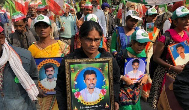 Women march with the photos of relatives who killed themselves because of the agrarian