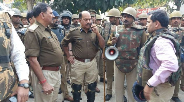 Policemen gather following reports of mob violence at Chingravati in