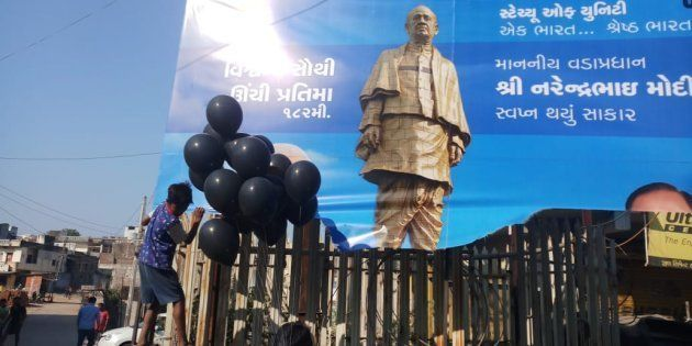 Demonstrators release black balloons to protest inauguration of Sardar Patel Unity Statue in