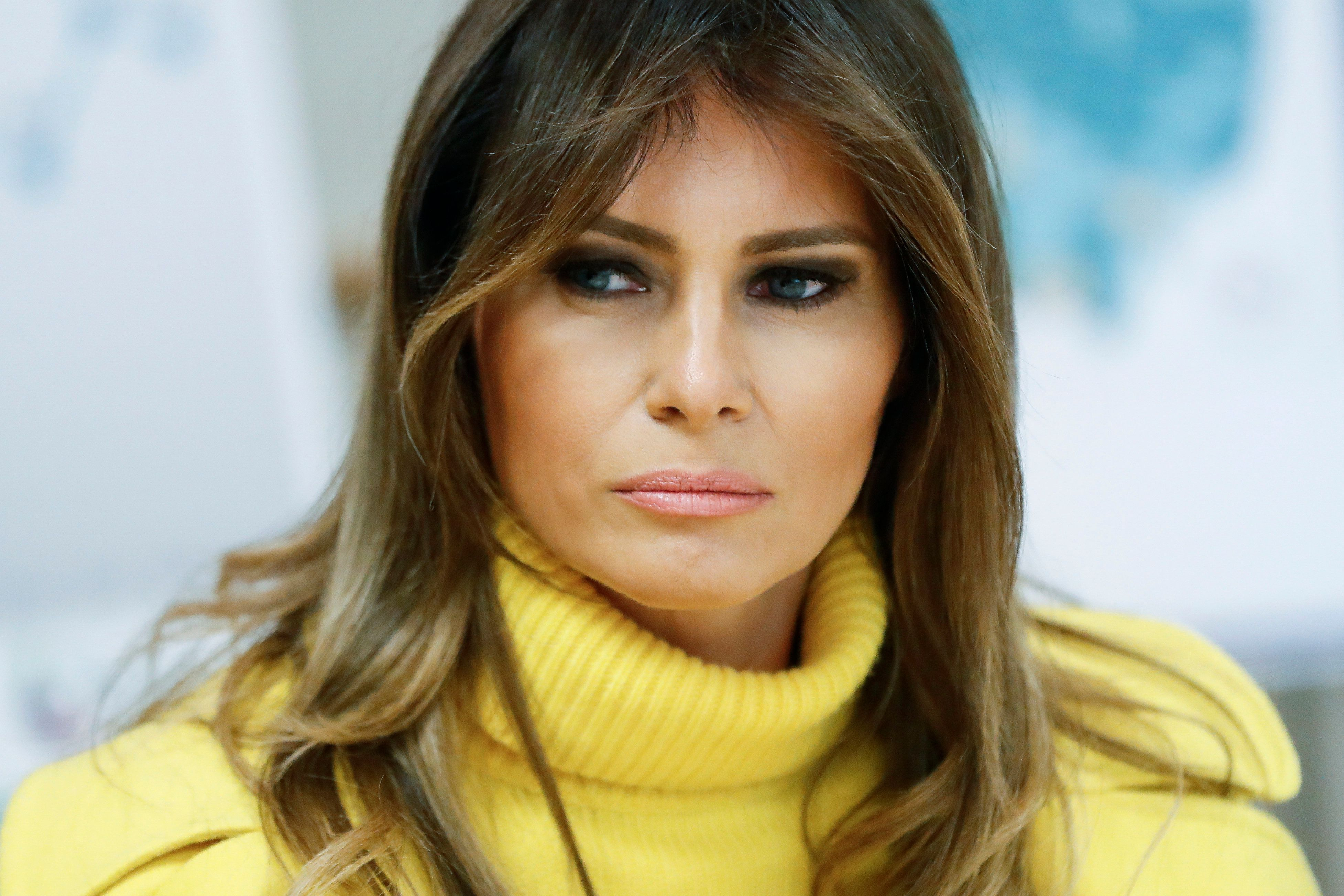 "In this Feb. 5, 2018 photo, first lady Melania Trump listens as she meets with personnel at Cincinnati Children's Hospital Medical Center, in Cincinnati. Melania Trump has cut ties with an adviser whose firm was paid $26 million to help plan the president's inauguration. Mrs. Trump's spokeswoman, Stephanie Grisham, confirms Tuesday that the first lady's office has ""severed the gratuitous services contract"" it had with Stephanie Winston Wolkoff.  (AP Photo/John Minchillo)"