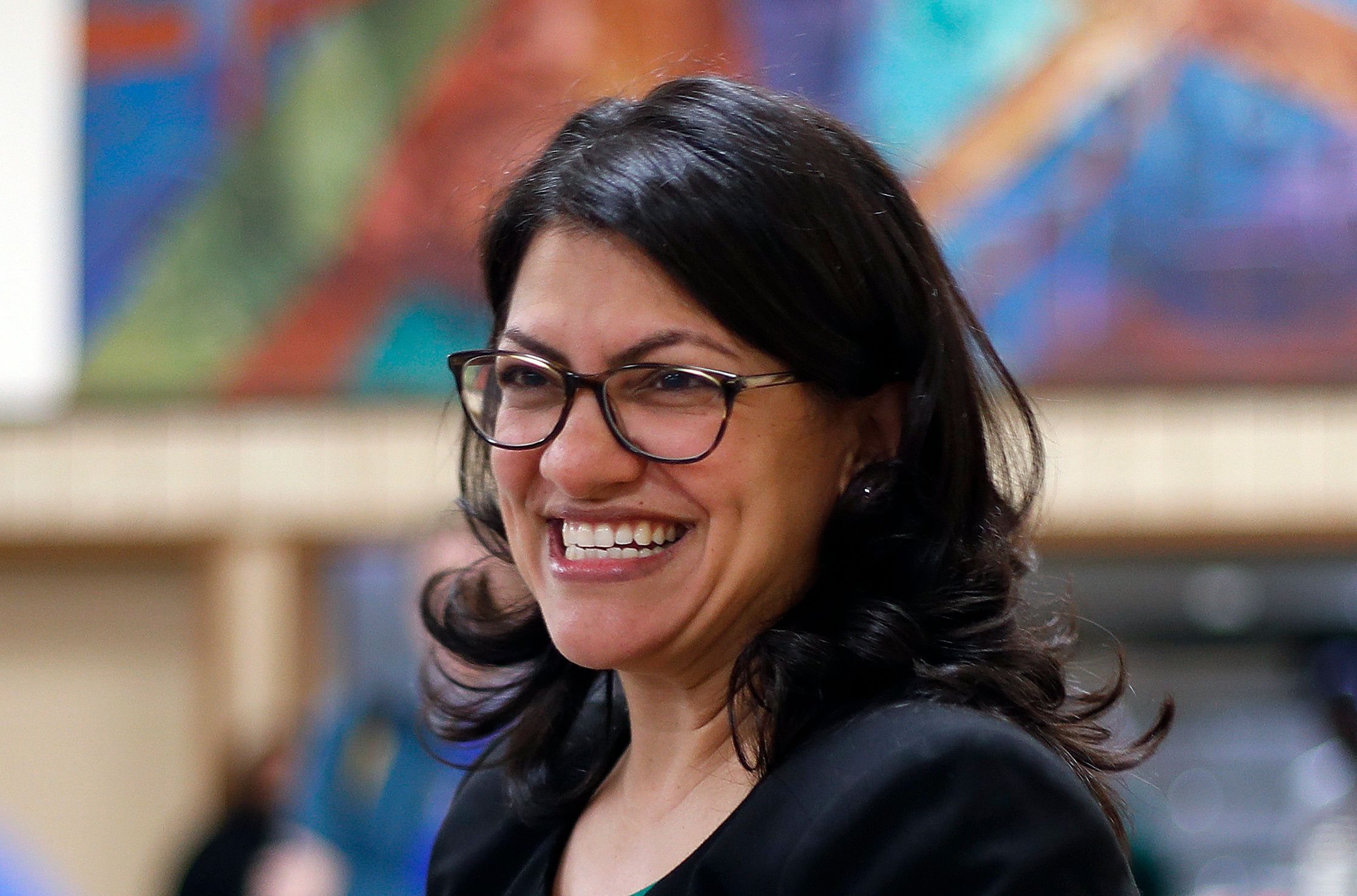 FILE - In this Oct. 26, 2018 file photo, Rashida Tlaib, Democratic candidate for the Michigan's 13th Congressional District, smiles during a rally in Dearborn, Mich. (AP Photo/Paul Sancya, File)
