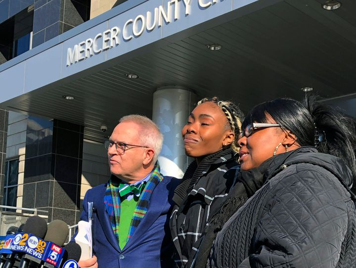 Jazmine Headley, center, joins attorney Brian Neary and her mother, Jacqueline Jenkins, outside a courthouse in Trenton, New