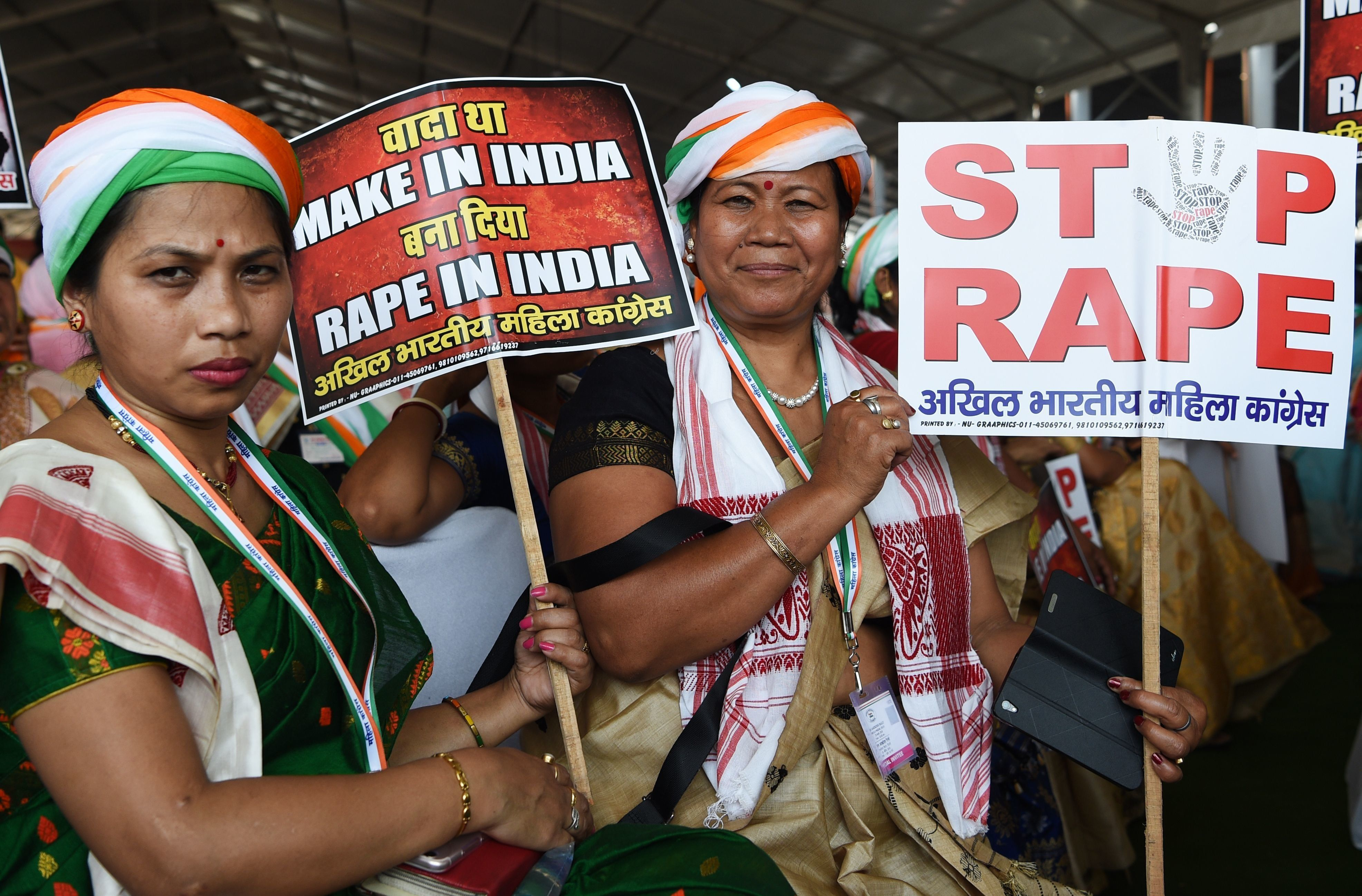 Supporters of President of the Indian National Congress Party Rahul Gandhi hold placards in reaction to the recent rape cases in India during a rally dubbed Jan Aakrosh Rally (public outrage), in New Delhi on April 29, 2018. - The rally was Gandhi's first in the national capital since taking over as the party chief last year. The rally was called to launch a protest against Prime Minister Narendra Modi government's failures and corruption. (Photo by Sajjad HUSSAIN / AFP)        (Photo credit should read SAJJAD HUSSAIN/AFP/Getty Images)