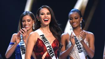 Catriona Gray (C) of the Philippines reacts after being selected as top five finalist while Natalia Carvajal (L) of Costa Rica and Akisha Albert (R) of Curacao applauds during the 2018 Miss Universe Pageant in Bangkok on December 17, 2018. (Photo by Lillian SUWANRUMPHA / AFP)        (Photo credit should read LILLIAN SUWANRUMPHA/AFP/Getty Images)