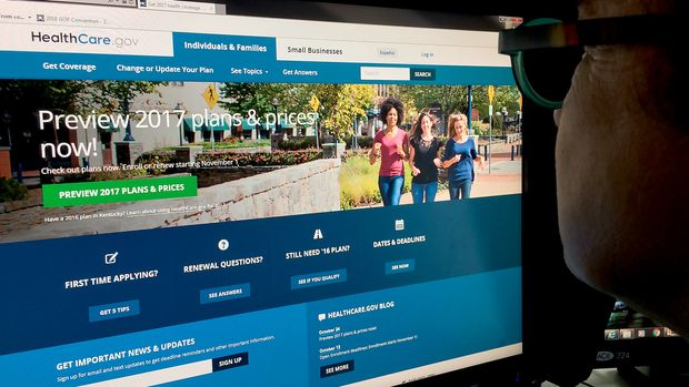 This October 25, 2016 photo shows a woman looking at the Healthcare.gov internet site in Washington, DC. Americans will see Obamacare health insurance costs jump an average of 25 percent next year, adding fuel to the US political firestorm over the system that Republicans have repeatedly tried to overturn. The big increase will be seen in the 38 states with federally-managed health care exchanges, according to a report released late October 24, 2016 by the Department of Health and Human Services.  / AFP / Karen BLEIER        (Photo credit should read KAREN BLEIER/AFP/Getty Images)