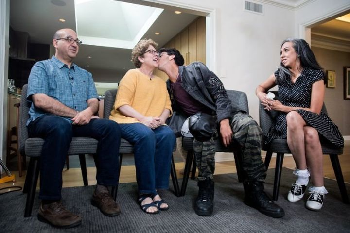Michael Matt kisses his mother, Judy Matt, while waiting to be interviewed on camera by reporter Lisa Belkin (out of frame) f