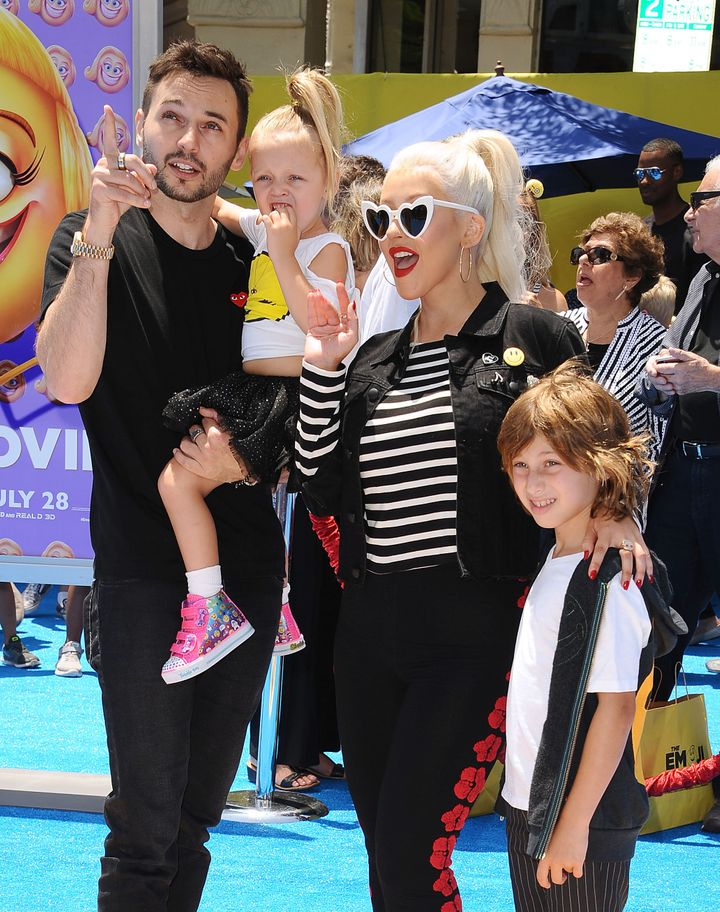 "Aguilera with her family at the premiere of ""The Emoji Movie"" in Los Angeles, July 23, 2017."