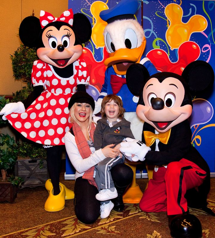 Aguilera with Max in 2010 at Disneyland in Anaheim, California.