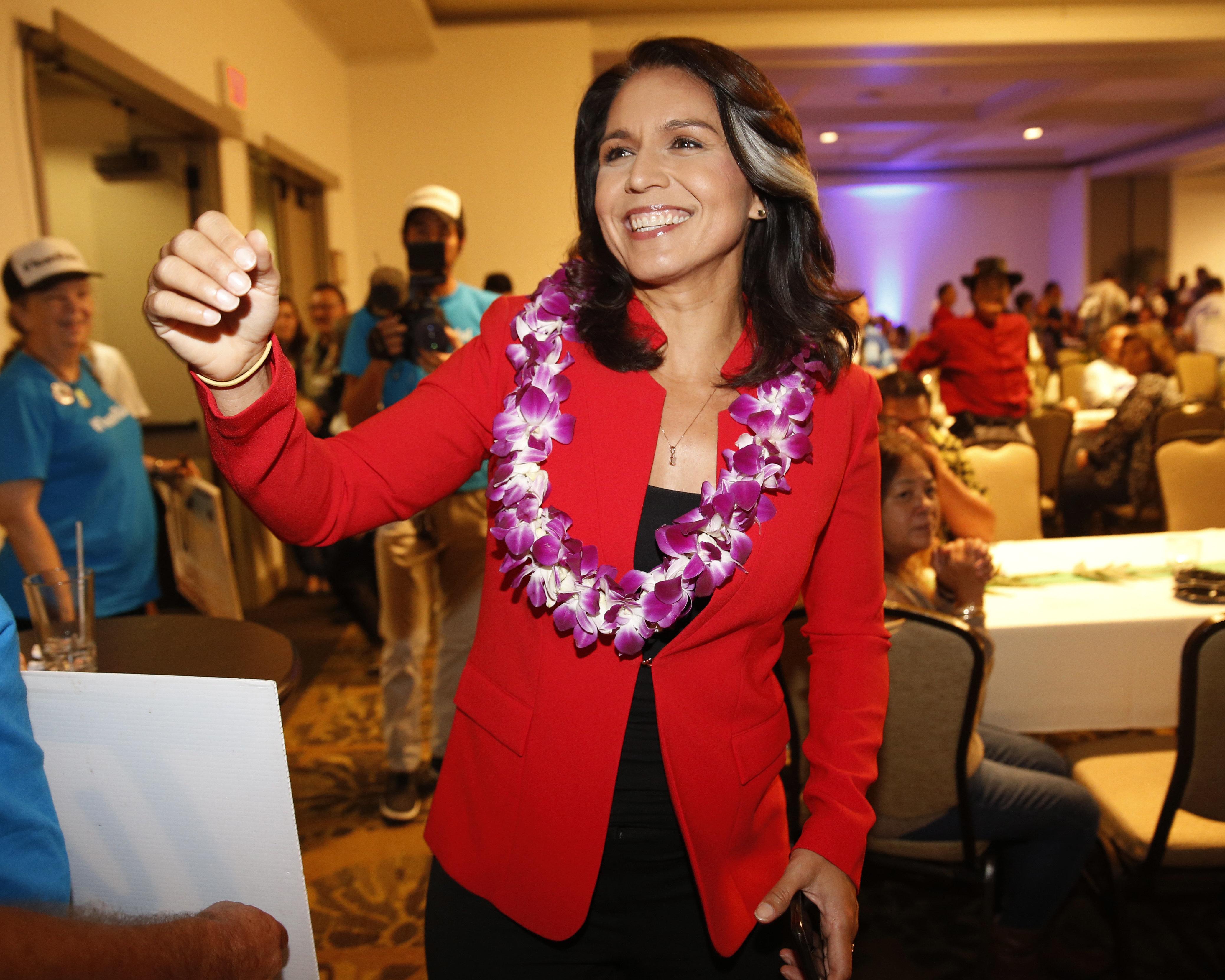Rep. Tulsi Gabbard, D-Hawaii, greets supporters Tuesday, Nov. 6, 2018, in Honolulu. (AP Photo/Marco Garcia)