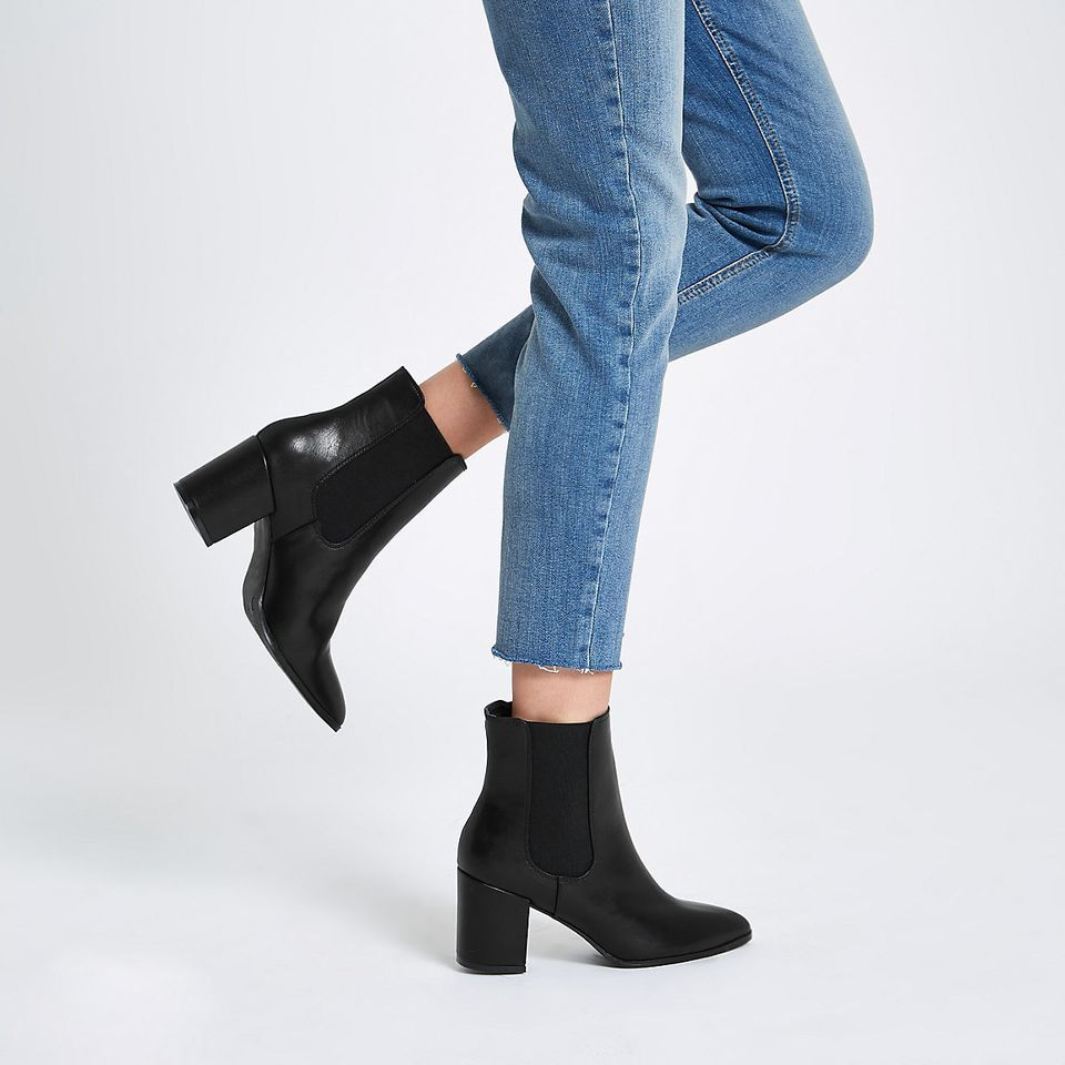 """These boots are so comfortable because of the block heel. I can be on my feet all day and they look great with cropped jeans"