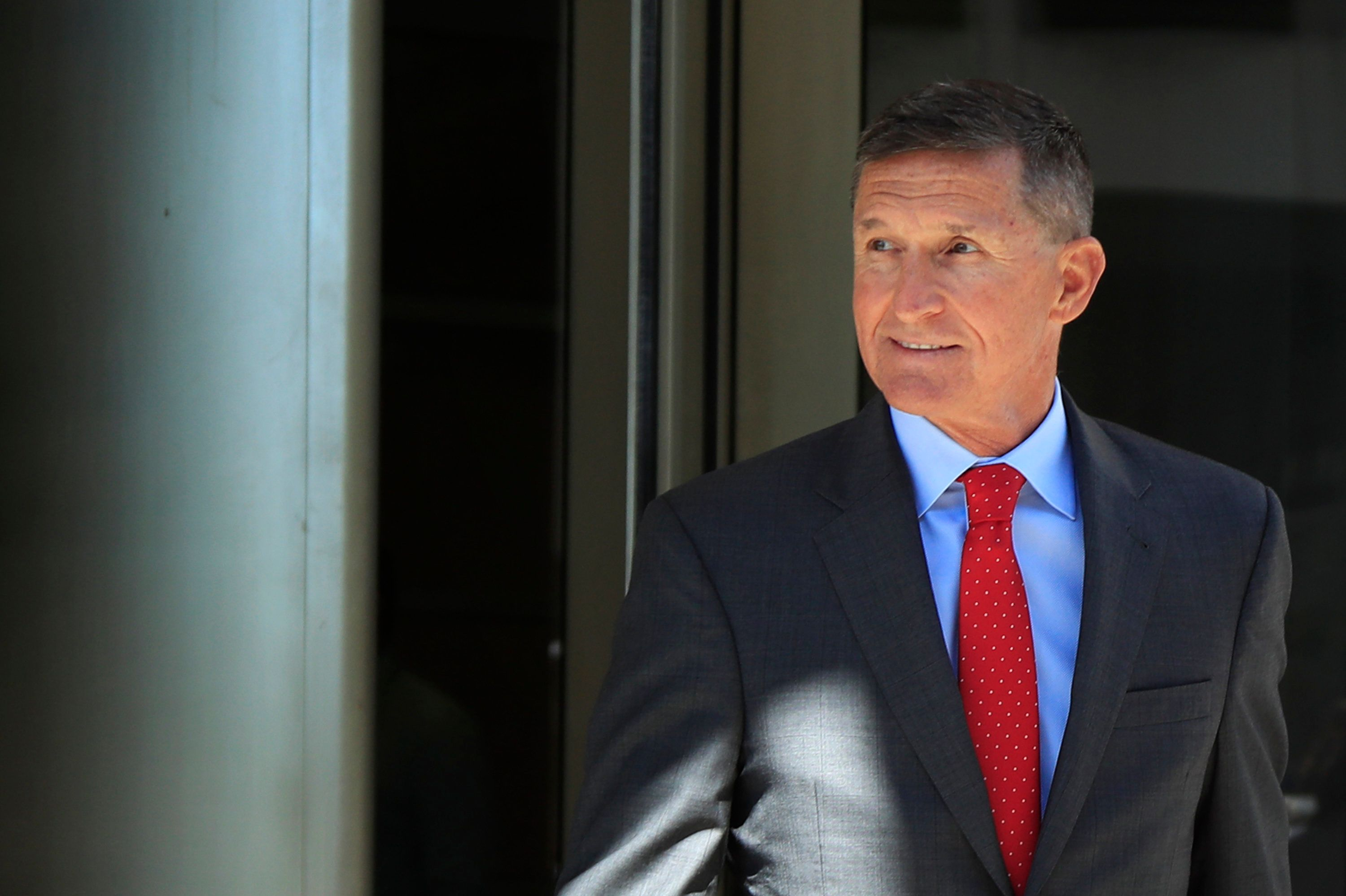 FILE - In this July 10, 2018, file photo, former Trump national security adviser Michael Flynn leaves the federal courthouse in Washington, following a status hearing. Michael Flynn may have given extraordinary cooperation to prosecutors, but the run-up to his sentencing hearing has exposed tensions over an FBI interview in which the former national security adviser lied about his Russian contacts. (AP Photo/Manuel Balce Ceneta, File)