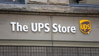 'Seattle, Washington, USA - May 19, 2012: The UPS Store downtown Seattle is a retail branch of UPS.  United Parcel Service was originally founded in Seattle, in 1907.'
