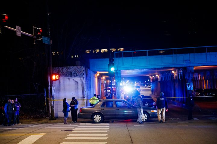 Police investigate the scene where two officers were killed after they were struck by a South Shore train near 103rd Street a