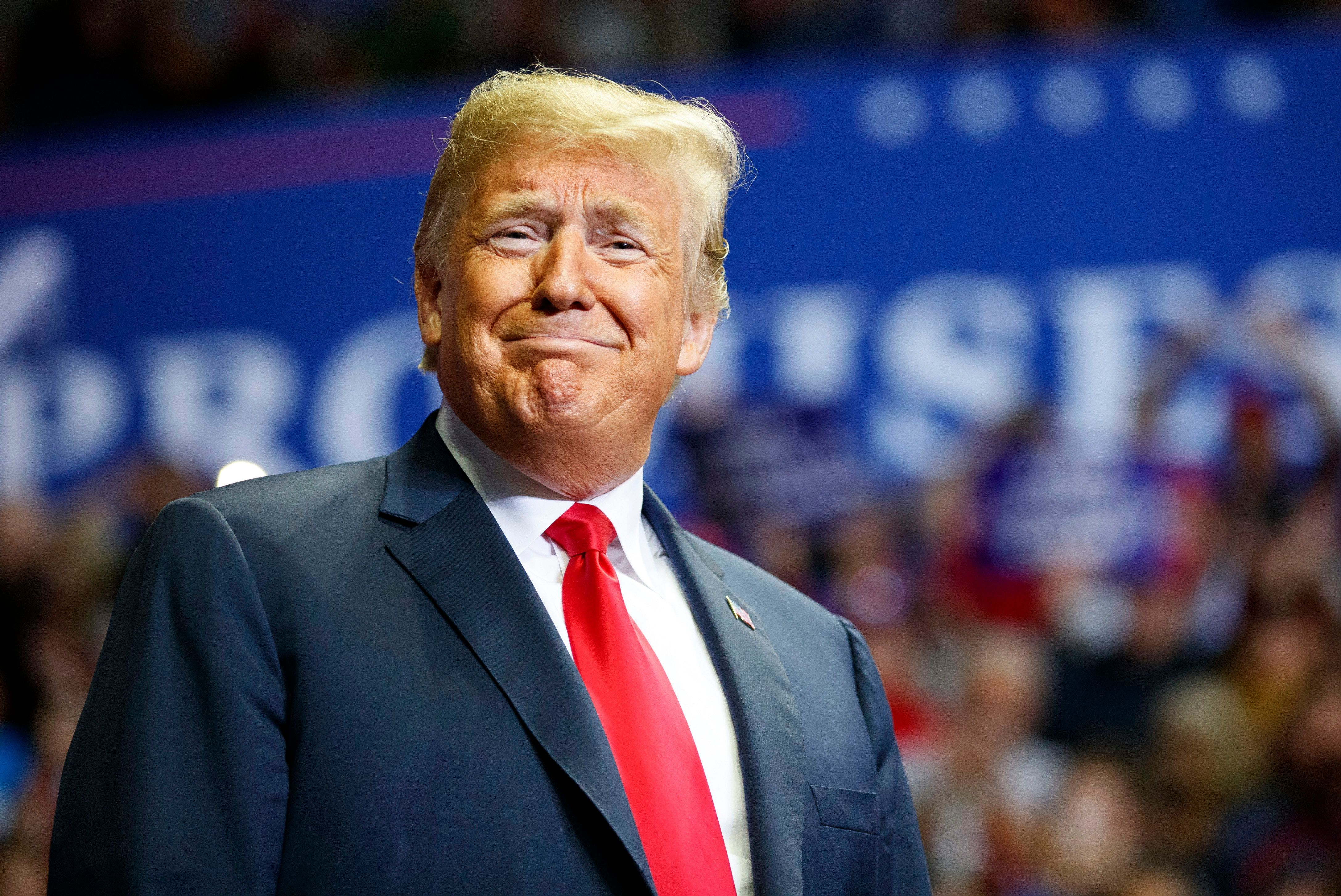 President Donald Trump looks to the cheering crowd as he arrives to speak at a rally at Allen County War Memorial Coliseum, Monday, Nov. 5, 2018, in Fort Wayne, Ind. (AP Photo/Carolyn Kaster)