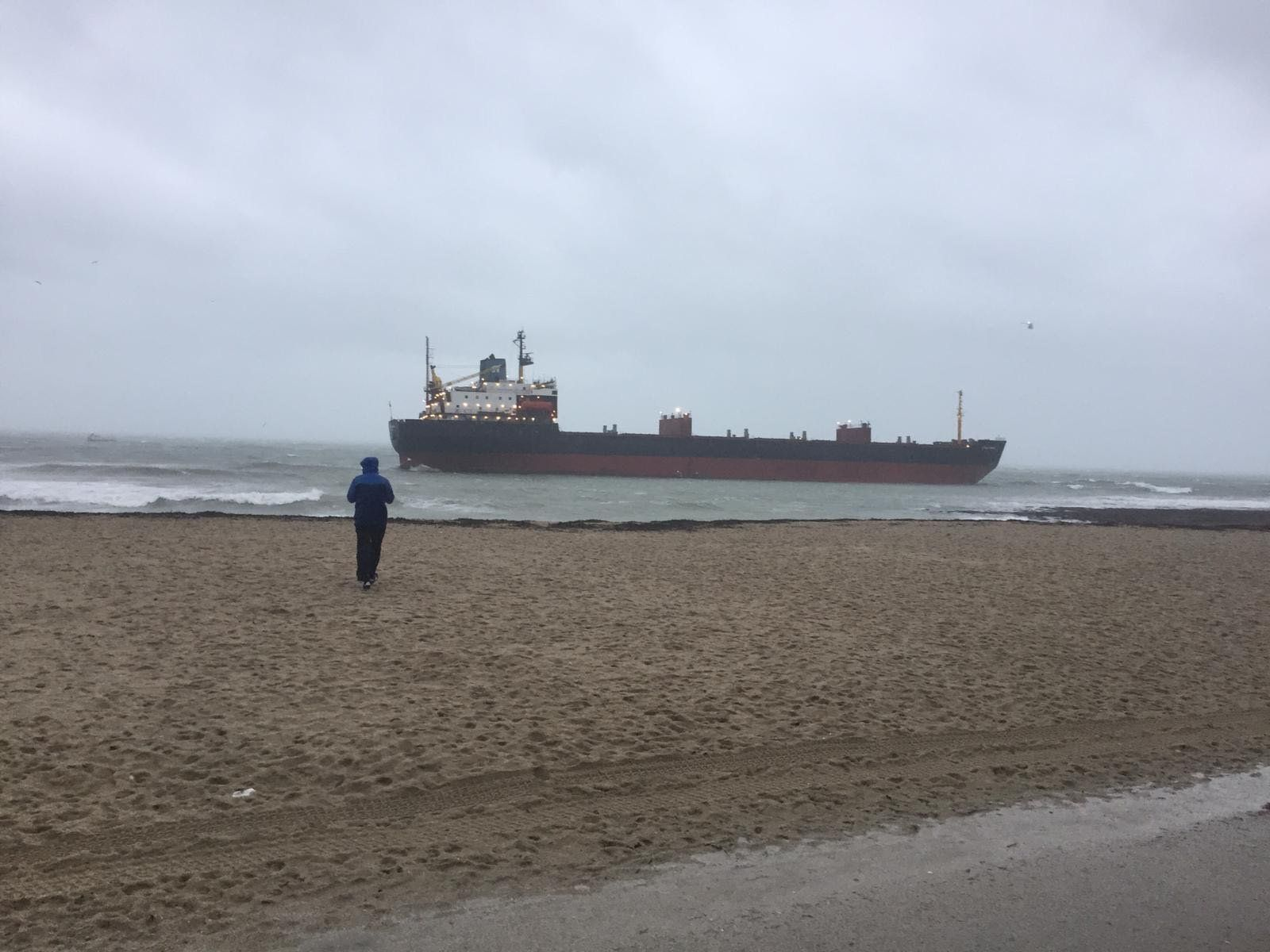 Massive cargo ship runs aground off Cornish beach