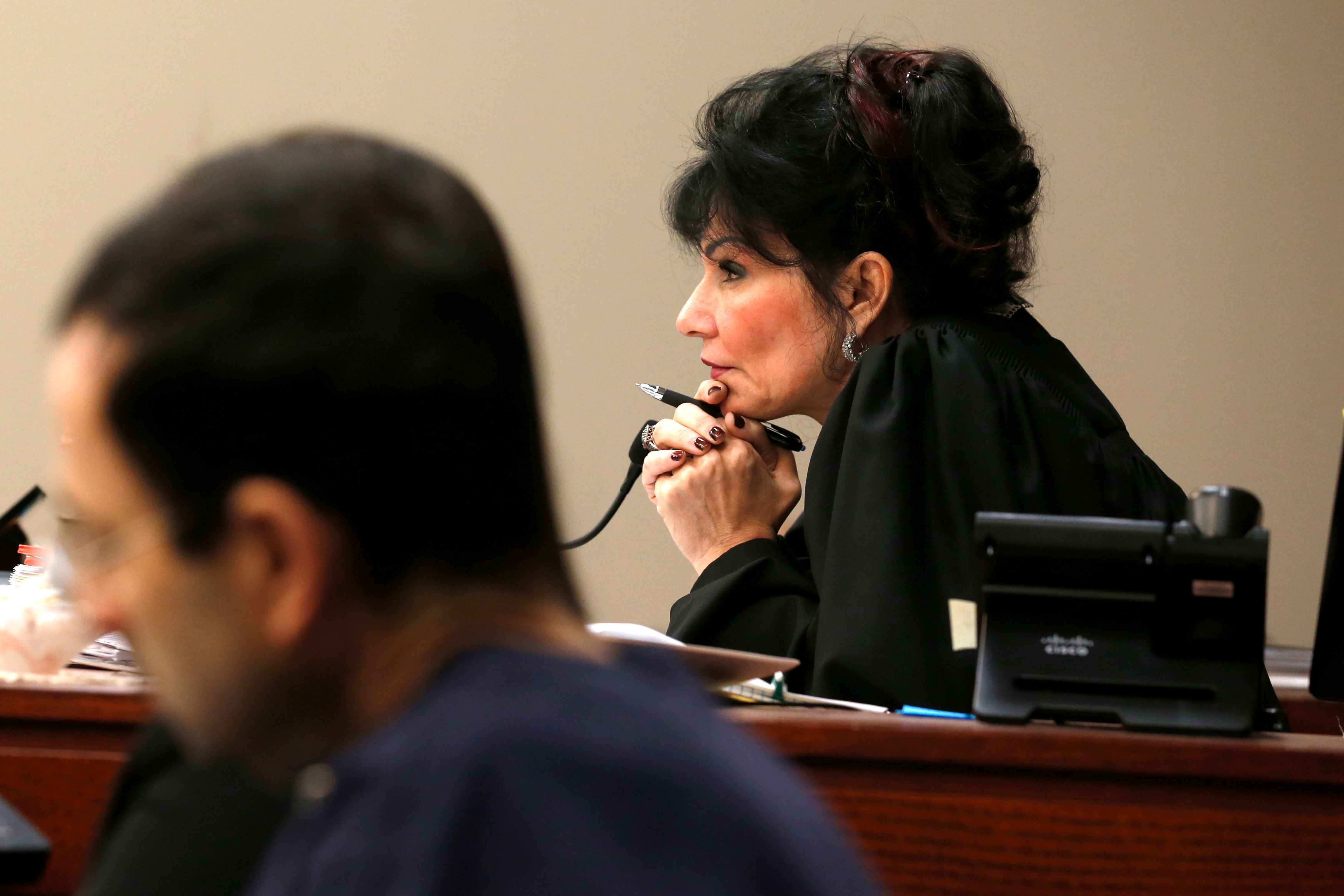 Judge Rosemarie Aquilina watches as Former Michigan State University and USA Gymnastics doctor Larry Nassar listens to impact statements during the sentencing phase in Ingham County Circuit Court on January 24, 2018 in Lansing, Michigan. More than 100 women and girls accuse Nassar of a pattern of serial abuse dating back two decades, including the Olympic gold-medal winners Simone Biles, Aly Raisman, Gabby Douglas and McKayla Maroney -- who have lashed out at top sporting officials for failing to stop him.    / AFP PHOTO / JEFF KOWALSKY        (Photo credit should read JEFF KOWALSKY/AFP/Getty Images)