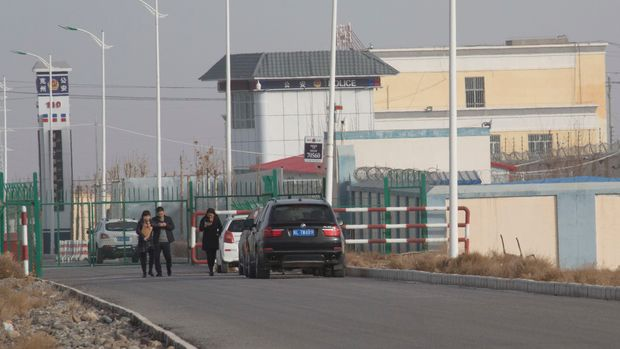 "CORRECTS TO SAY MANUFACTURING AND FOOD INDUSTRIES ONLY, NOT SERVICE INDUSTRY - In this Dec. 3, 2018, photo, a police station is seen inside the Artux City Vocational Skills Education Training Service Center at the Kunshan Industrial Park in Artux in western China's Xinjiang region. Across the Xinjiang region, a growing number of internment camps have been built, where by some estimates 1 million Muslims are detained, forced to give up their language and their religion and subject to political indoctrination. Now, the Chinese government is also forcing some detainees to work in manufacturing and food industries, in what activists call ""black factories."" (AP Photo/Ng Han Guan)"