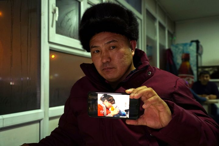 In this Dec. 9, 2018, photo, Orynbek Koksebek, a former detainee in a Chinese internment camp, holds up a phone showing a sta