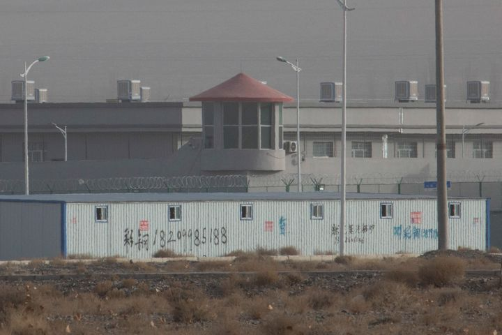 In this Monday, Dec. 3, 2018, photo, a guard tower and barbed wire fences are seen around a facility in the Kunshan Industria