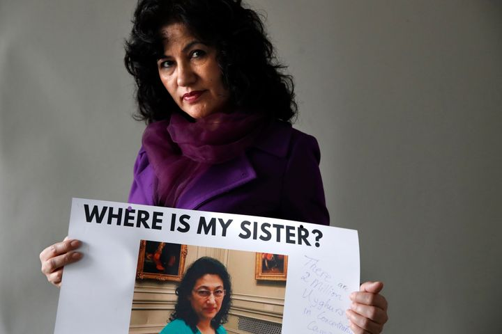Rushan Abbas, 51, of Herndon, Va., holds a photo of her sister, Gulshan Abbas, Monday, Dec. 17, 2018, in Washington. Rushan A