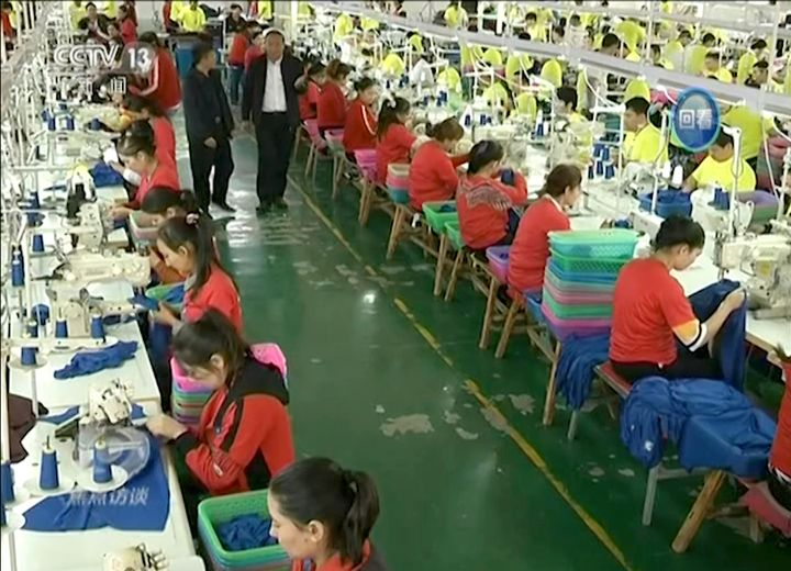 In this file image from undated video footage run by China's CCTV, Muslim trainees work in a garment factory at the Hotan Voc