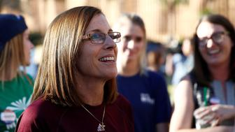 Republican U.S. Senate candidate Rep. Martha McSally, center, talks with people waiting in line at the ASU Palo Verde West polling station during the U.S. midterm elections in Tempe, Arizona, U.S. November 6, 2018. REUTERS/Lindsey Wasson