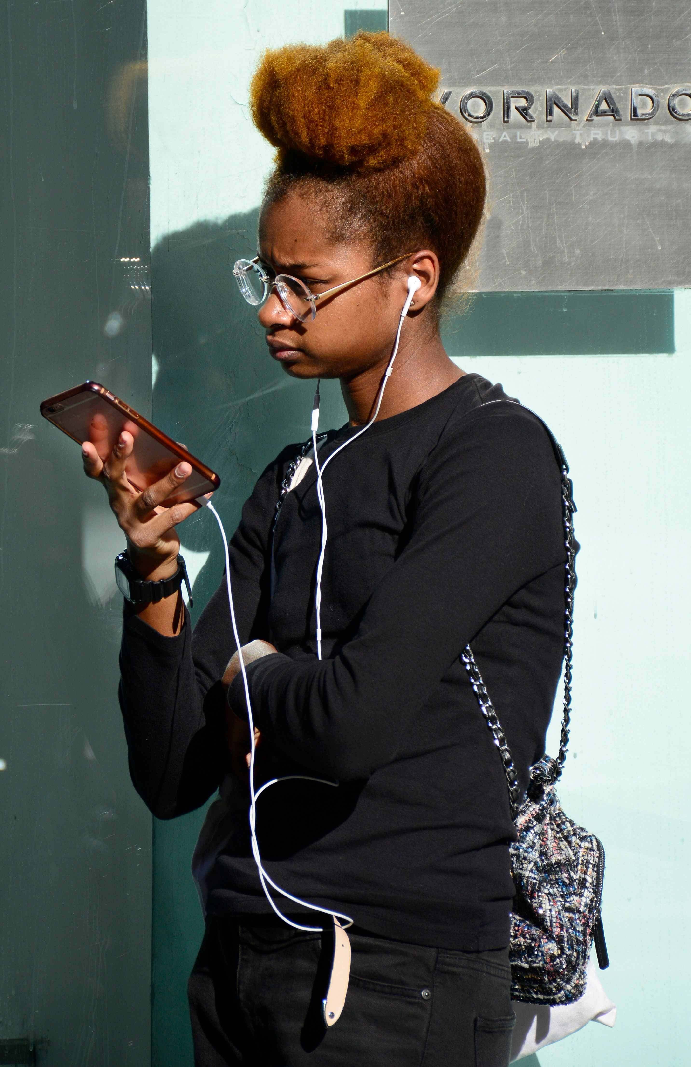 NEW YORK, NY - SEPTEMBER 22, 2017:  A young woman pauses on a New York City sidewalk to use her smartphone. (Photo by Robert Alexander/Getty Images)