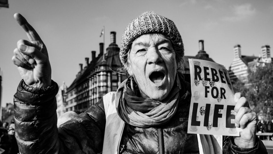 Extinction Rebellion activists gather on Nov. 17 in London, blocking the traffic in protest to demand...