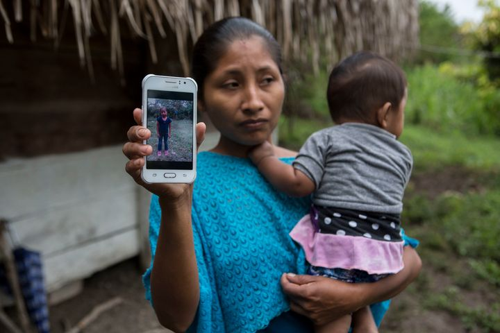 Claudia Maquin, 27, shows a photo of her daughter Jakelin Caal in Raxruha, Guatemala, on Dec. 15. The 7-year-old girl died in