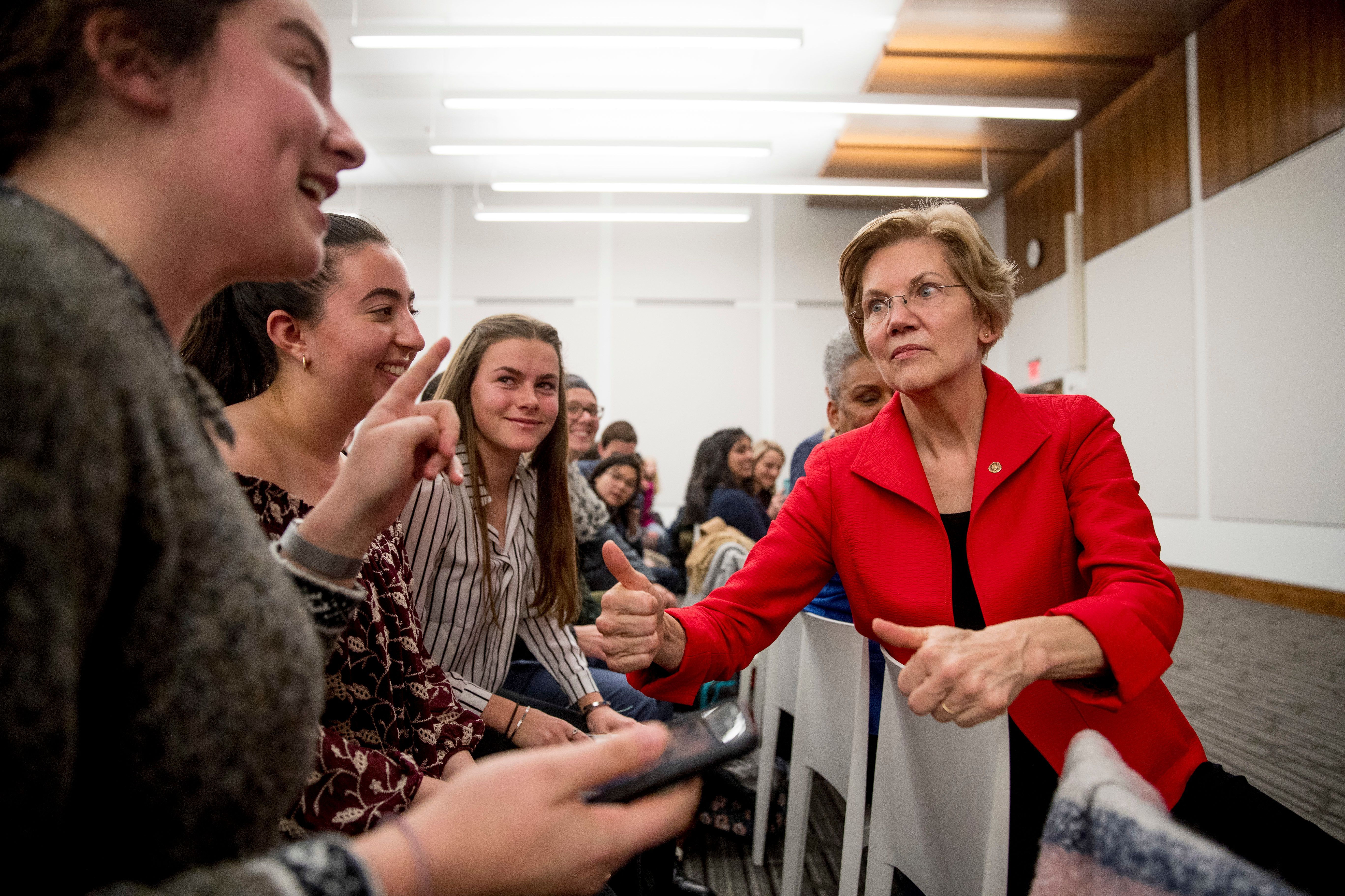 From left, American University freshmen Yardena Gerwin, Marissa Klass, and Karni Campbell greet Sen. Elizabeth Warren, D-Mass., after she speaks at the American University Washington College of Law in Washington, Thursday, Nov. 29, 2018, on her foreign policy vision for the country. (AP Photo/Andrew Harnik)