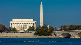 WASHINGTON D.C., Memorial Bridge spans Potomac River with rowers and features Lincoln Memorial and Washington Monument. (Photo by: Visions of America/UIG via Getty Images)